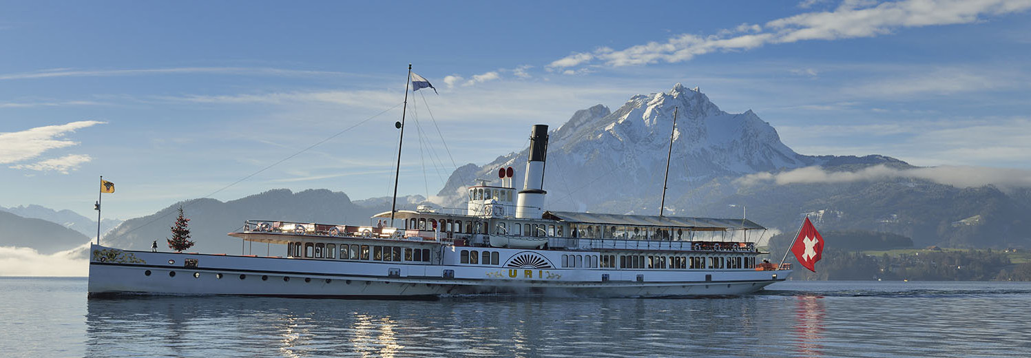 Driving steamboat Uri on Lake Lucerne in beautiful winter weather.