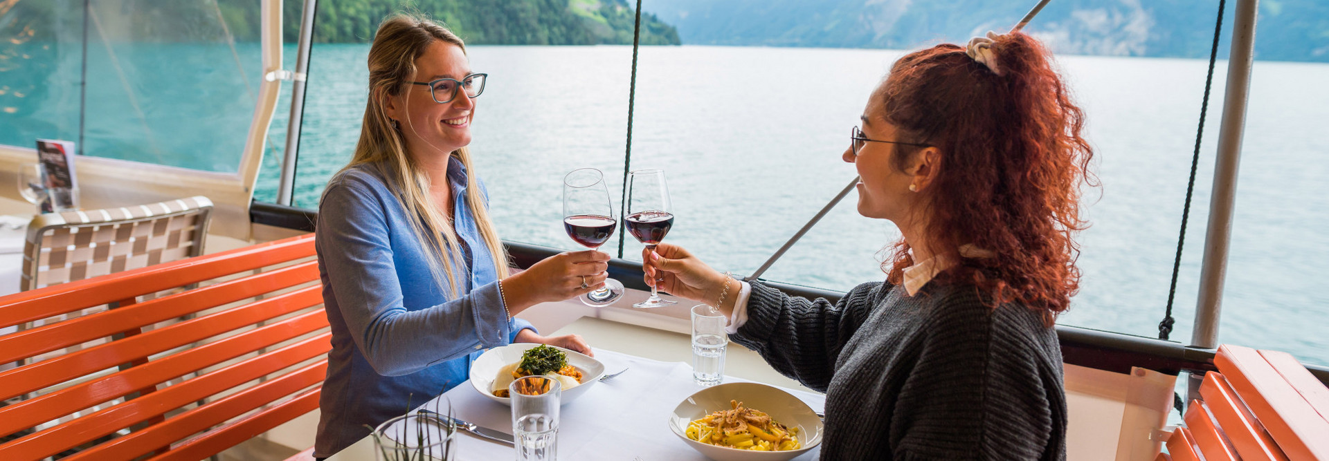 Guests are clinking their wine glasses during lunch